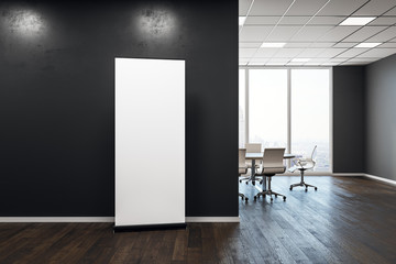 Contemporary meeting room with empty billboard