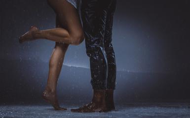 Couple sharing romantic moments under the rain