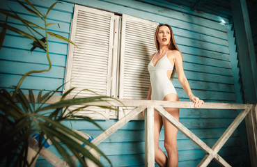 Beautiful girl posing in her summer house