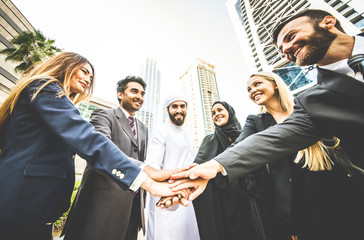 Arabic and western business people portrait. Motivational concept