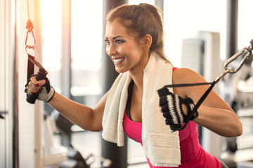 Beautiful woman at the gym doing workout