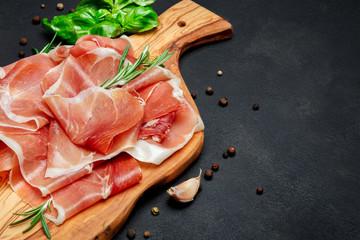Italian prosciutto crudo or spanish jamon. Raw ham on wooden cutting board
