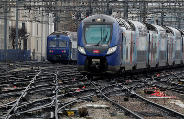 A TER (regional express train) and French state-owned railway company SNCF tracks are seen at Montparnasse train station in Paris
