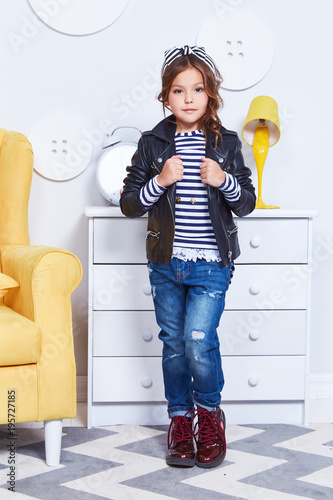 49e2605ca Fashion style clothes for child small little girl wear strip t-shirt denim  jeans lather jacket boots hat bow cute pretty face curly hair baby model  fun play ...