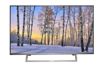Modern high-definition TV or monitor with winter landscape on screen