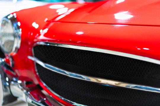 Radiator grill of Red Retro car garage in Berlin