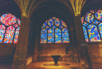 Beautiful old multi-colored stained glass window in church , France