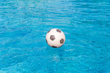 ball floating in the swimming pool