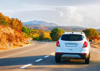 White car on road in Costa Smeralda Sardinia