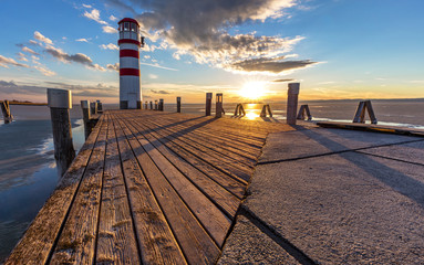 Lighthouse, dramatic sunset during winter