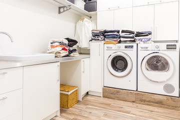 Stacks of clean clothes in utility room Wall mural