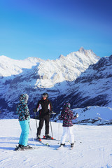 Skiers at winter sport resort Swiss Alps Mannlichen