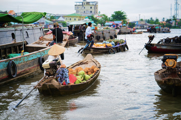 Woman selling fruit at Floating market in Can Tho