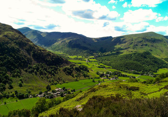 A green lush landscape in Buttermere in the Lake District Wall mural