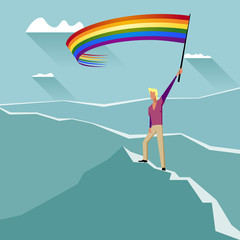 Man with LGBT Flag on a Mountain Peak