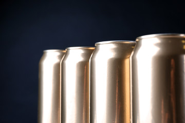 Cans of beer on dark background, closeup