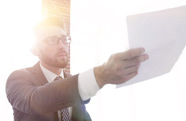 Image of business man holding paper
