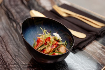 Photo sur Plexiglas Entree Marinated scallops and raw vegetables in bowl