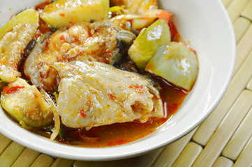 spicy fried catfish with curry and eggplant on bowl