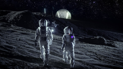 Following Shot of Two Astronauts in Space Suits Walk on the Alien Planet Looking at the Sky. In the Background Base with Geodesic Dome. Other Worlds Colonization and Space Travel Concept.
