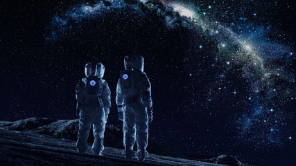 Crew of Two Astronauts in Space Suits Standing on the Moon Looking at the The Milky Way Galaxy. High Tech Concept of Moon Colonization and Space Travel. Fotomurales