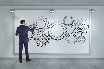 Businessman drawing gears sketch on a board 3D rendering