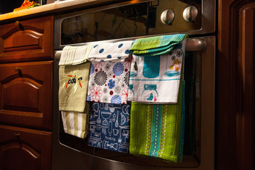 colored cotton towels on the kitchen stove in the house