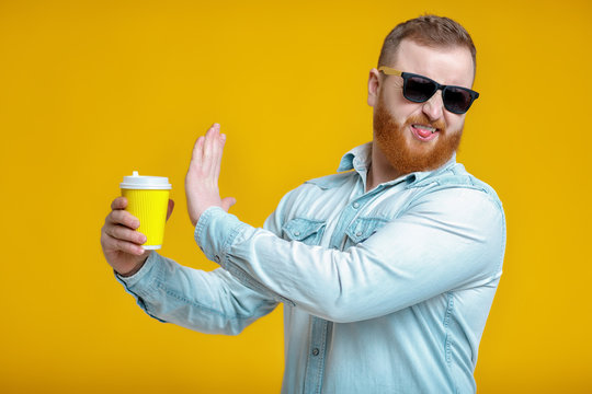 red beard man holding cup with coffee