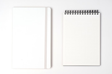 Notebook and notepad on White background