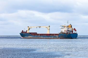 Cargo ship in the Baltic sea bay.
