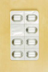 Close-up on a blister pack with tablets.