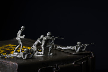 Toy soldiers displayed on an ammunition can