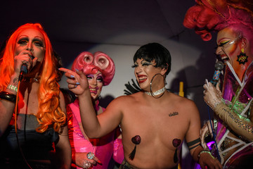 Drag performers celebrate onstage after the end of a drag queen competition called MR(S) BK in the Brooklyn borough in New York City