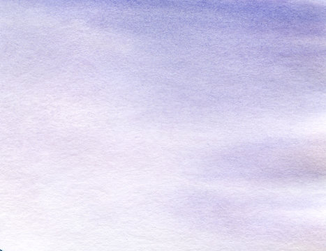 real Watercolor background with a gradient of blue and lilac color with a brightly degenerated paper texture. Hand-drawn