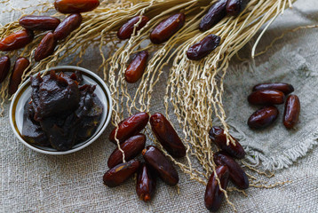 Raw Organic Fresh dates together with fint jam and dry branch from dates.