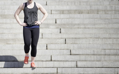 Young woman doing fitness  workout on stairs.