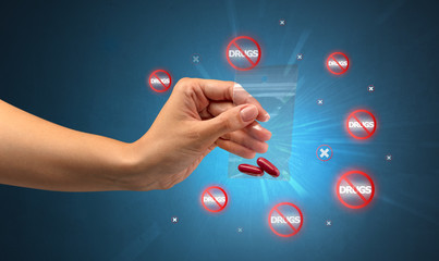 Anti-drug concept and hand giving pills