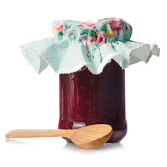Raspberry jam in a jar wooden spoon
