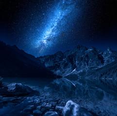 Fototapete - Milky way at the lake in Tatras, Poland