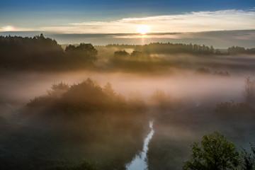 Sunrise at foggy valley in autumn, Poland