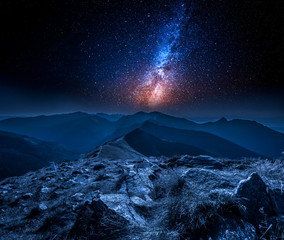 Fototapete - Stunning milky way in mountains at night in Poland