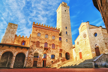 Aluminium Prints Historical buildings Picturesque View of famous Piazza del Duomo in San Gimignano at sunset, Tuscany, Italy