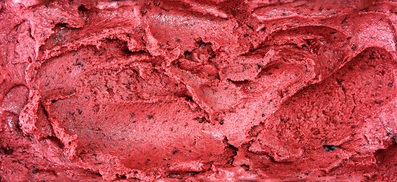 Top view of red sorbet surface made from berries