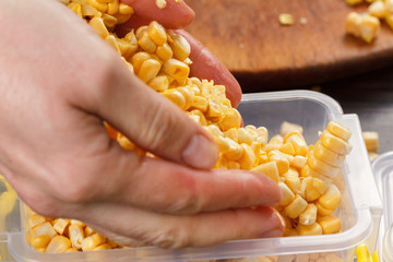 Trays with raw corn for freezing.