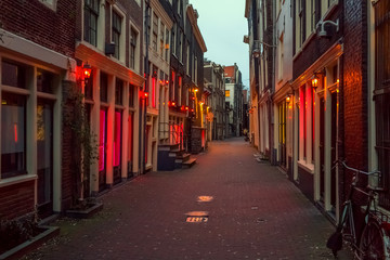 Canvas Prints Amsterdam Red light district in Amsterdam, the Netherlands, night view. Windows and doors where prostitutes work