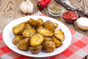 Slices of potato-grilled with rosemary