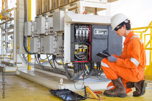 Oil And Gas Measuring Instruments : Quot electrical and instrument technician measuring voltage of