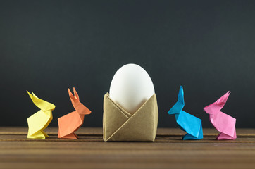 Easter eggs and colorful Easter bunnies, origami, accessories for cards and congratulations with Easter.