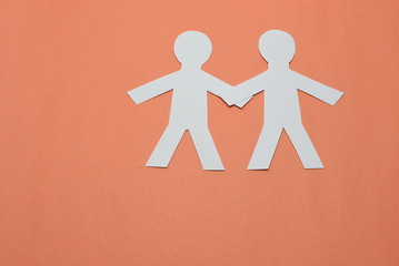 two male silhouettes in white on orange background