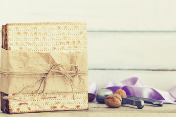 Pack of matzah or matza on a vintage wood background.Jewish Passover holiday composition with copy space and blurred background or bokeh.
